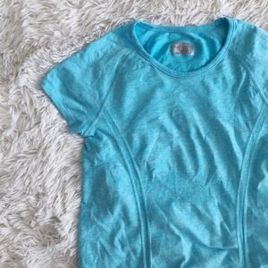 ATHLETA turquoise fast track work out short sleeve